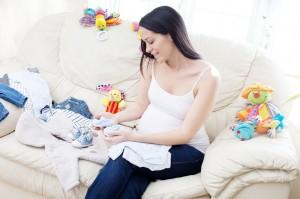 Happy pregnant caucasian brunette  woman