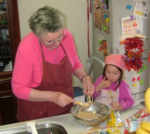 640px-Taste-testing_the_cookie_dough_with_Grandm